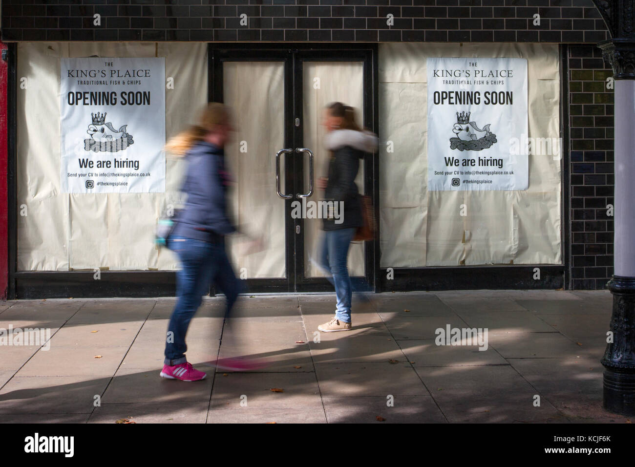Out of focus figures passing, Businesses in decline, CBD Central business district, Prime Location, Retail Units, - Stock Image