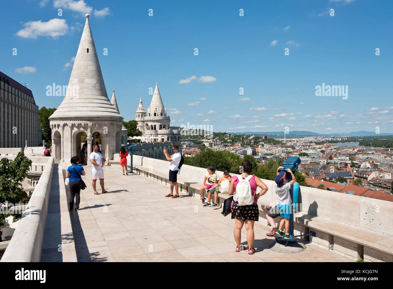 Tourists on the walls of the Fisherman's Bastion in Budapest looking at the view and taking photographs pictures Stock Photo