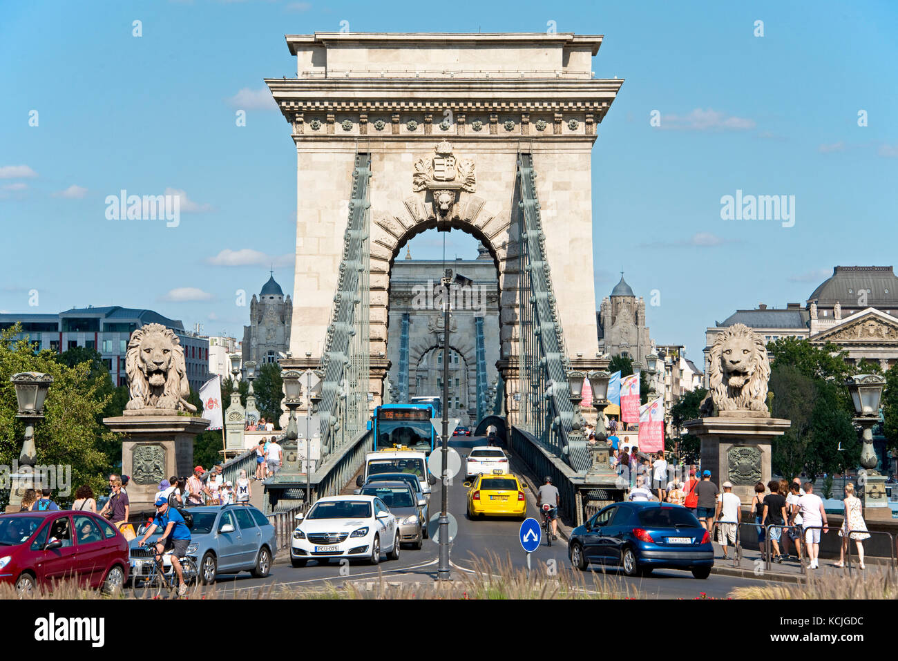 From the Buda side of Budapest a compressed perspective view of tourists, traffic, cars, vehicles entering and leaving - Stock Image