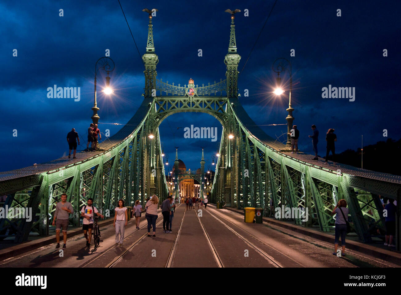 The Liberty Bridge in Budapest is occaisionally closed to all traffice where people can walk and climb on it - sometimes Stock Photo