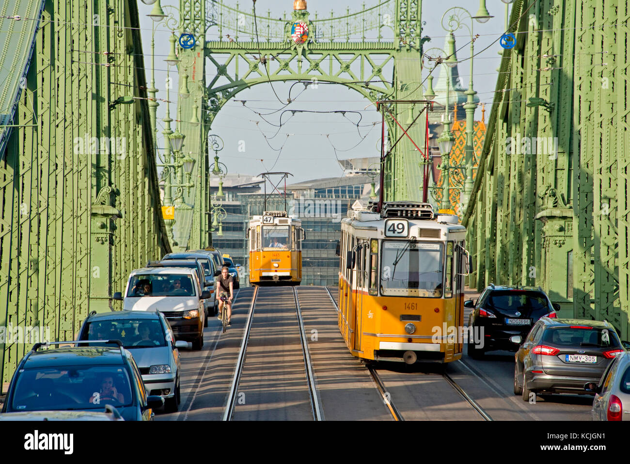 The Ganz CSMG tram in Budapest crossing the Liberty Bridge on a sunny day with blue sky. - Stock Image