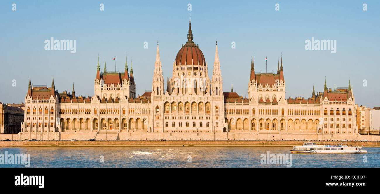 A 3 picture stitch panoramic view of the Hungarian Parliment Building on the Danube river in Budapest with a river Stock Photo