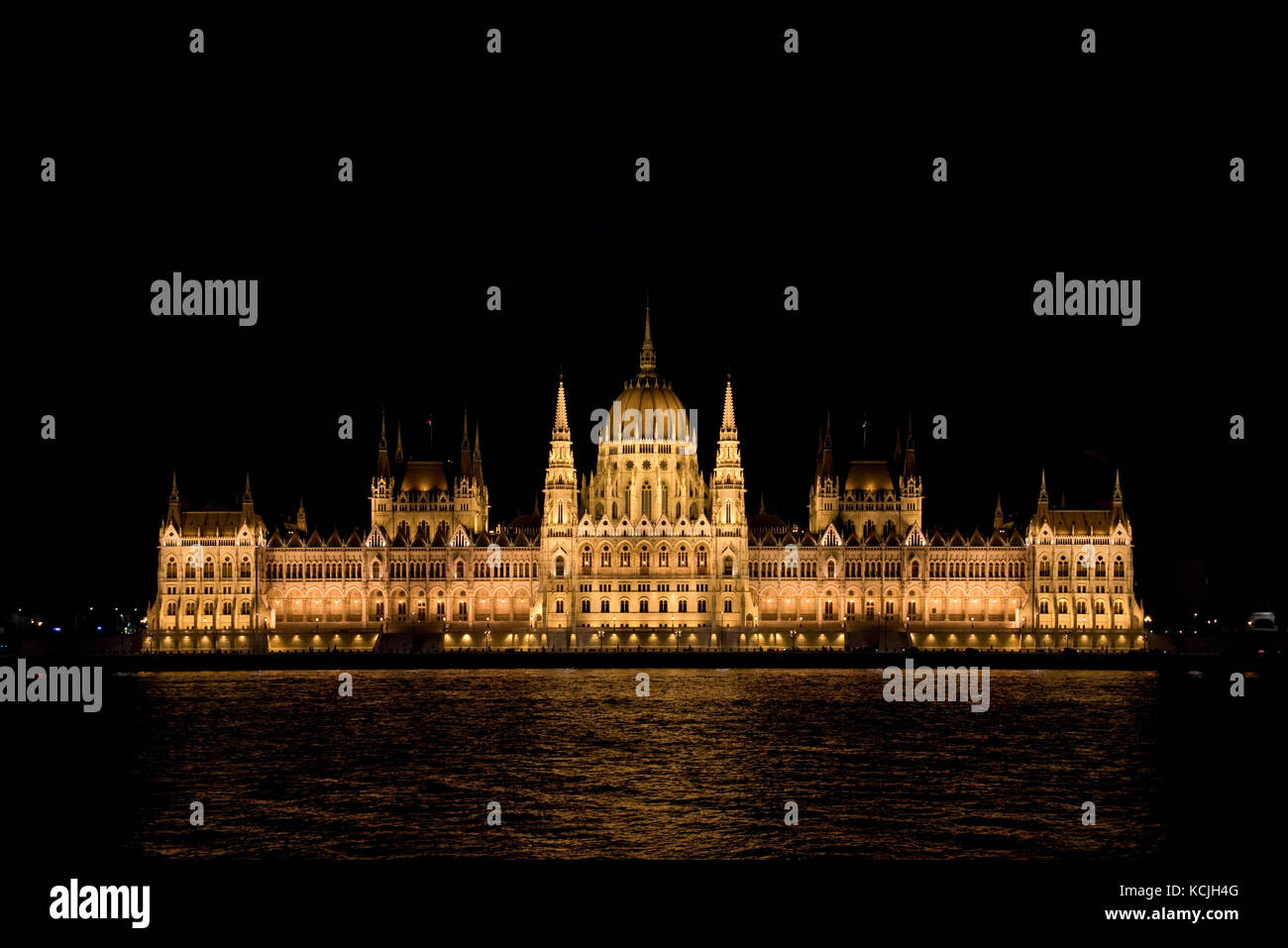 An evening nighttime view of the Hungarian Parliment Building on the Danube river in Budapest. - Stock Image