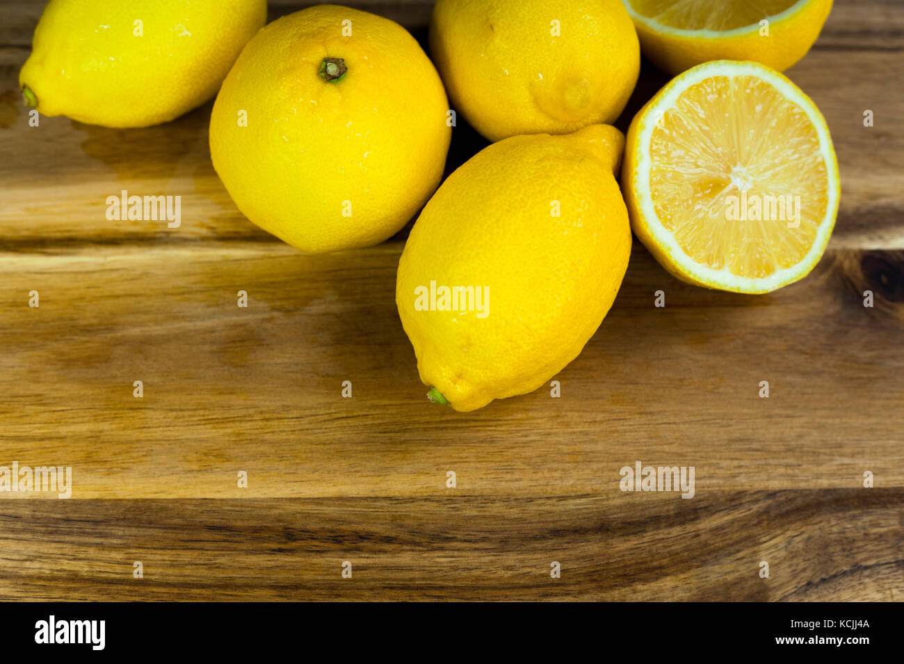closeup photo of ripe yellow lemons - Stock Image