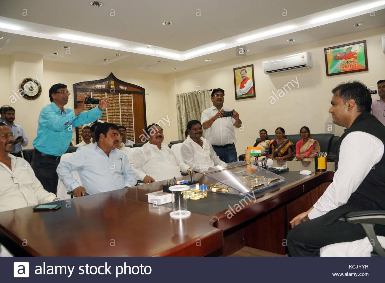 Deputy Commissioner of West Singhbhum, Sri Arava Rajkamal,IAS in discussion with state BJP chief Laxman Gilua , - Stock Image