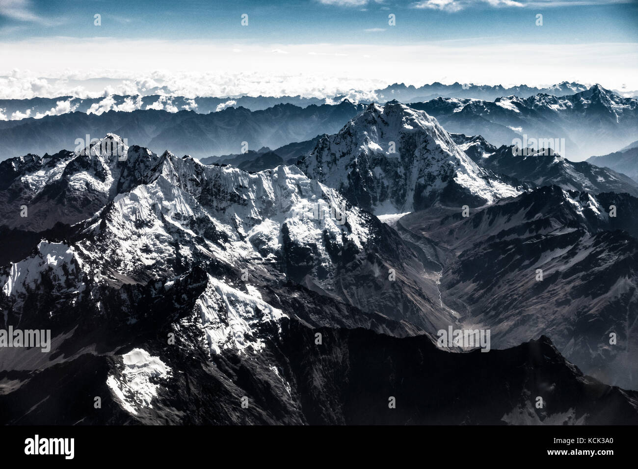 An aerial view of the snow capped Peruvian Andes, shot from an airplane on the way into Cusco, Peru. - Stock Image