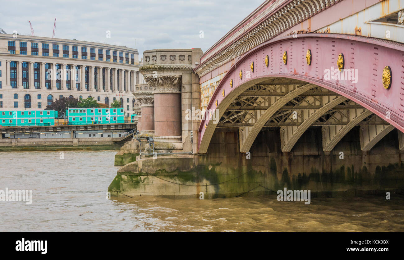 Side and underside of the Victorian era Blackfriars Bridge, in regular use for people and vehicles, as a River Thames - Stock Image