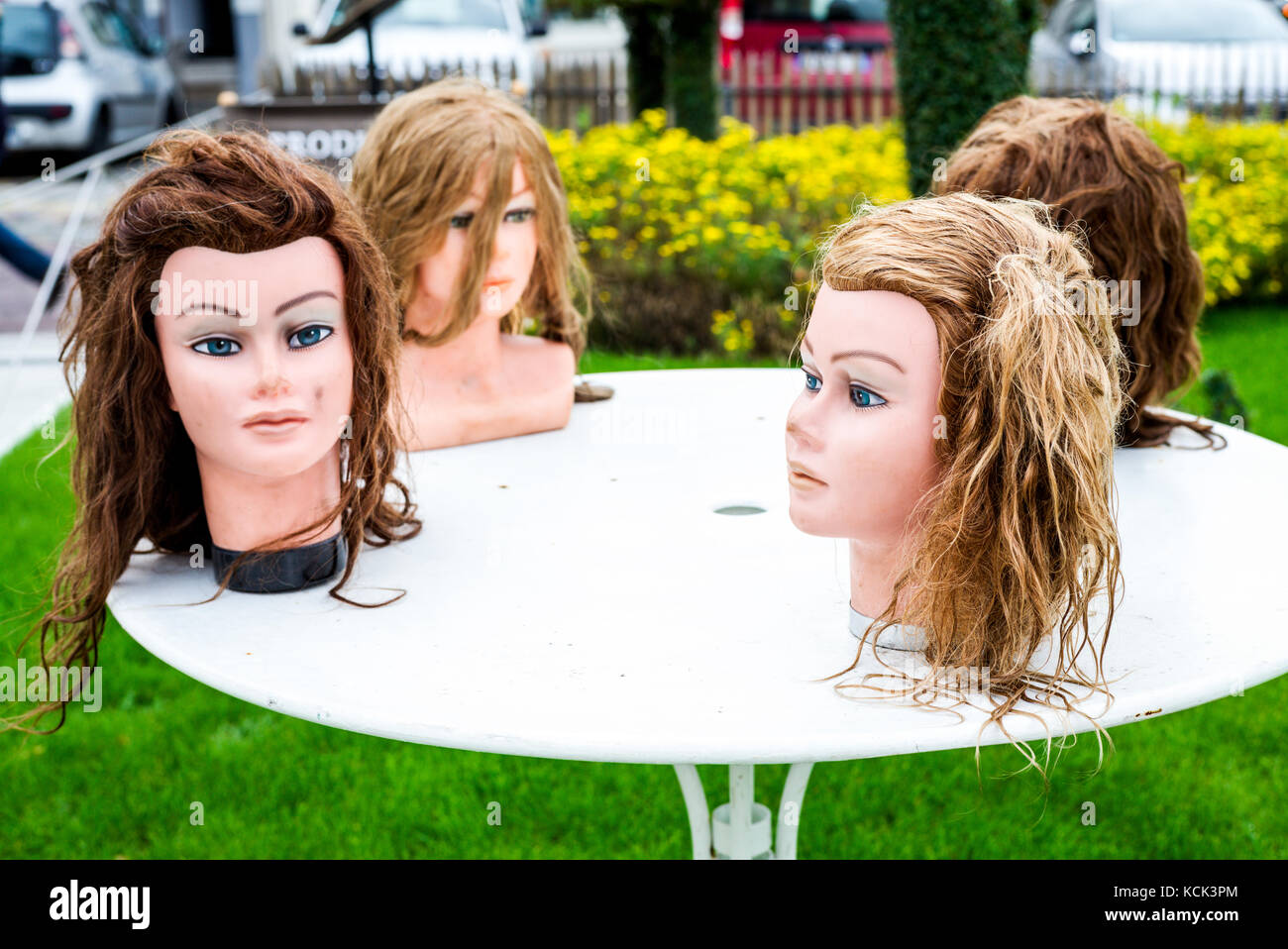 Manequin heads on a table in Boulogne-sur-Mer - Stock Image