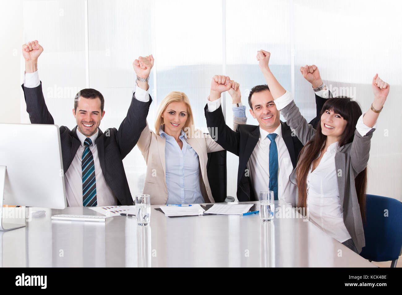 Happy Business Team In Office Celebrating Success Stock Photo Alamy