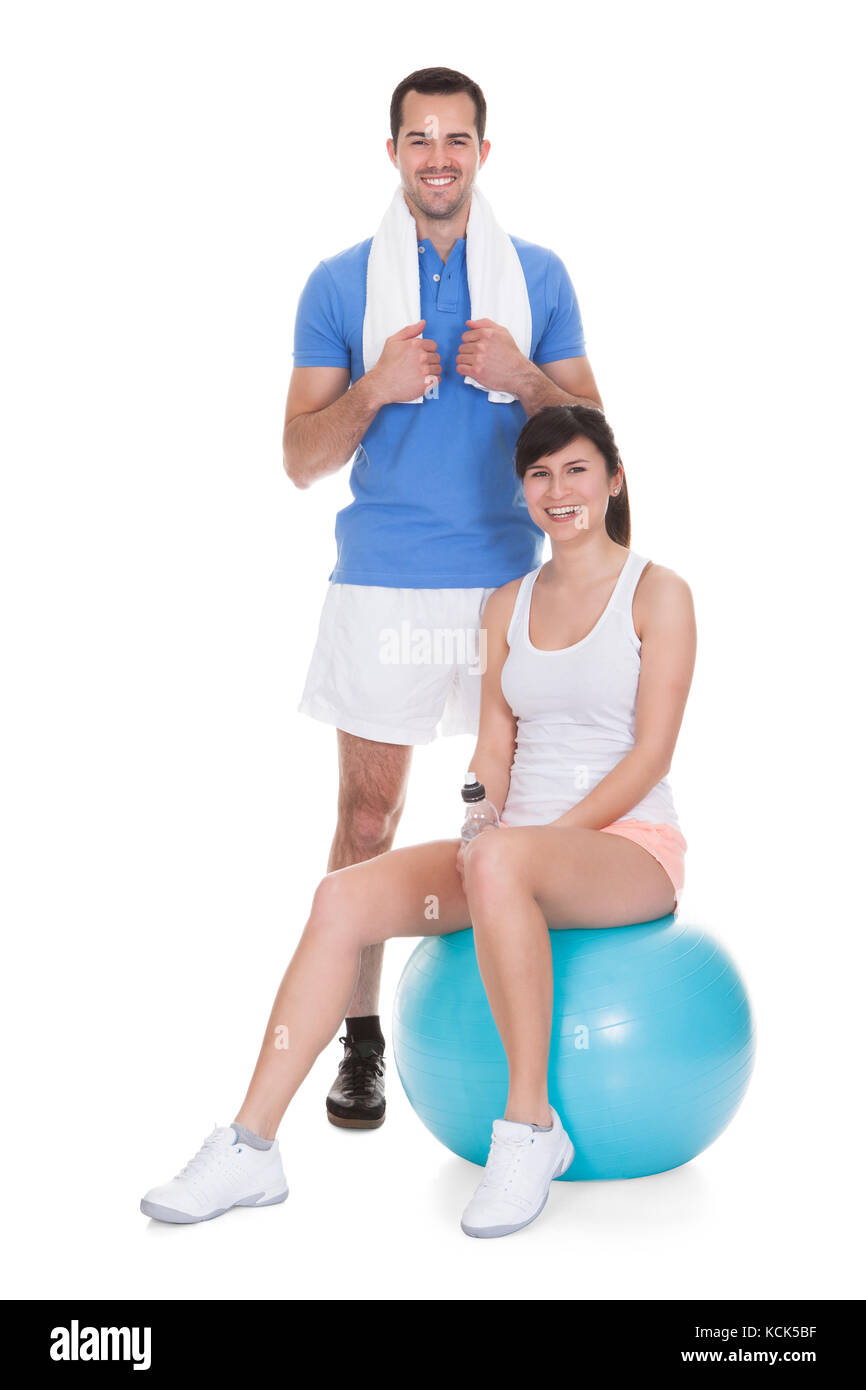 Happy Couple Working Out Over White Background - Stock Image