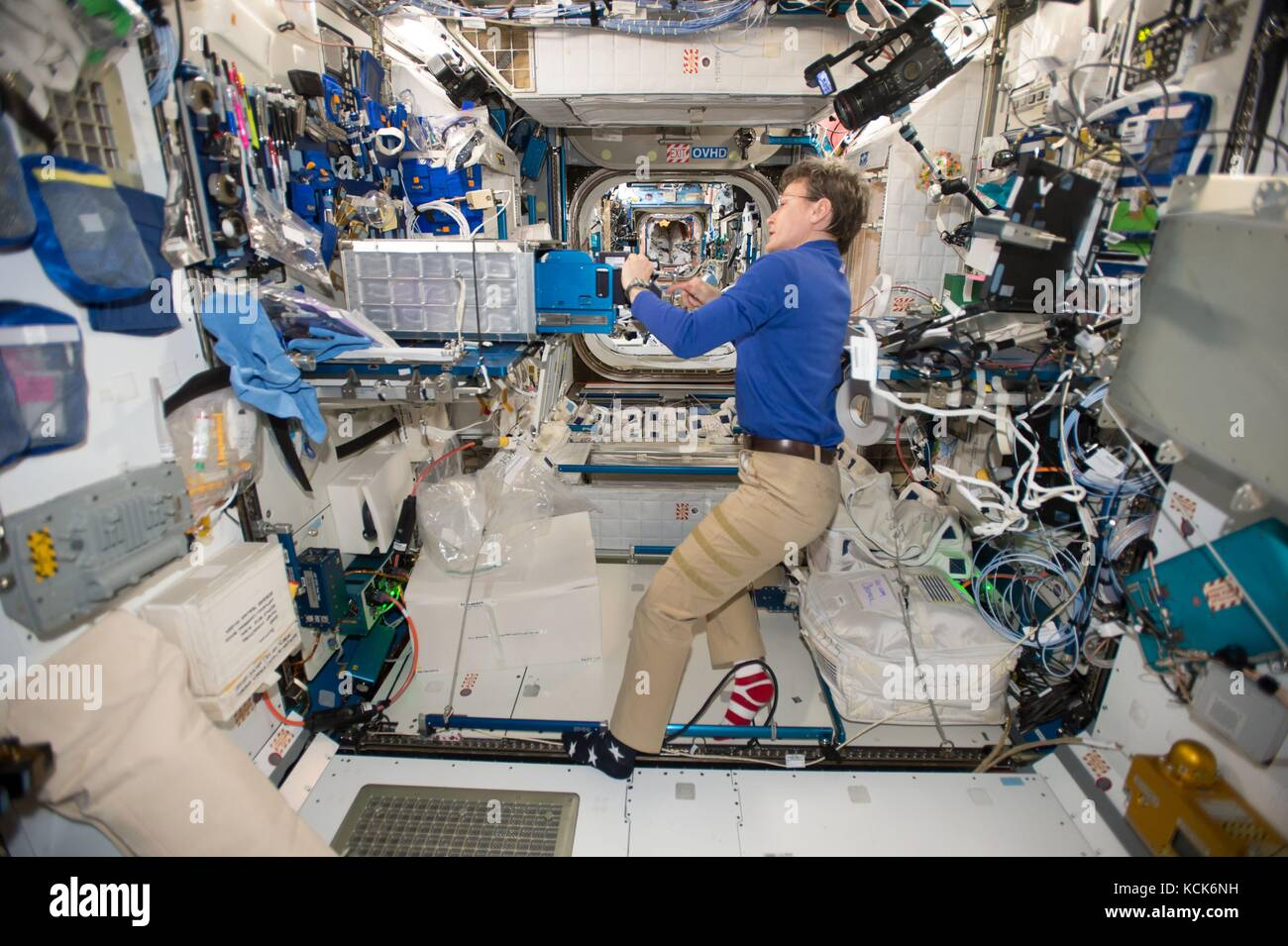 NASA International Space Station Expedition 51 prime crew member American astronaut Peggy Whitson changes out the - Stock Image