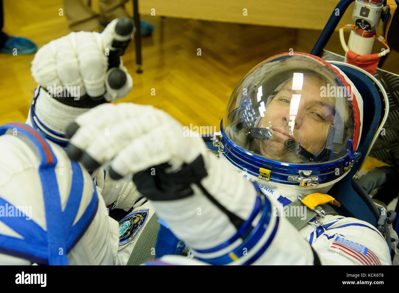 NASA International Space Station Expedition 52 prime crew member American astronaut Randy Bresnik has his Sokol Stock Photo