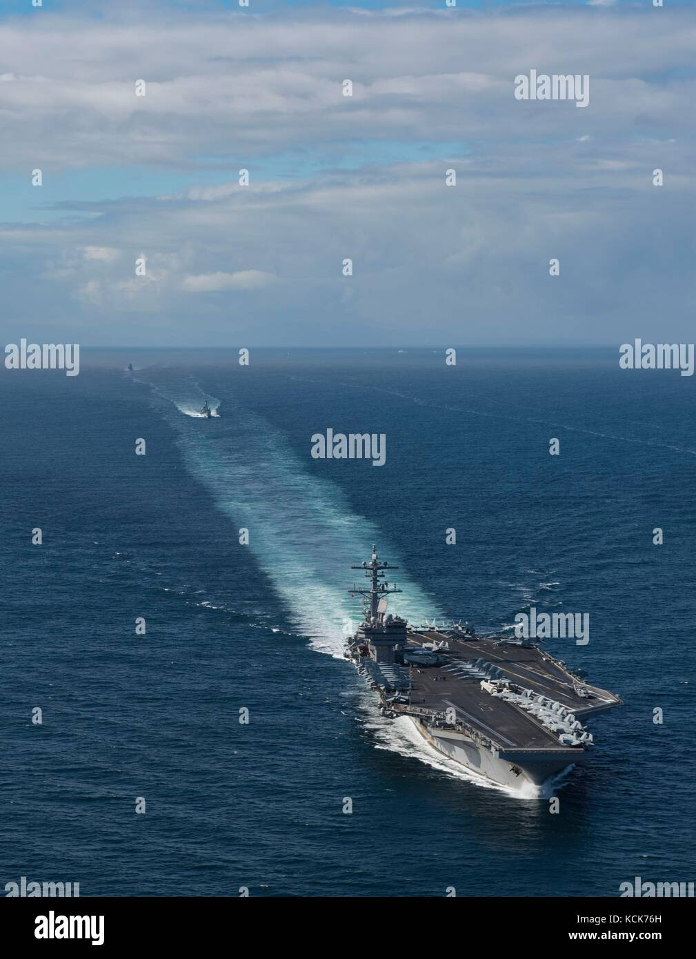 The U.S. Navy Nimitz-class aircraft carrier USS George H.W. Bush steams in formation with British and Norwegian Stock Photo