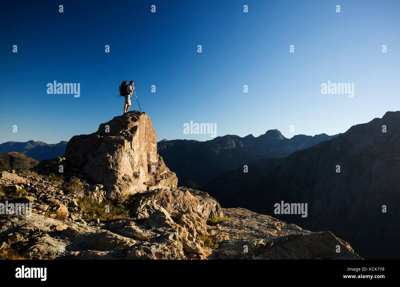A lone hiker on the Flower Ridge trail overlooks the Henshaw/Shepherd Creek watershed in Strathcona Park, Central - Stock Image