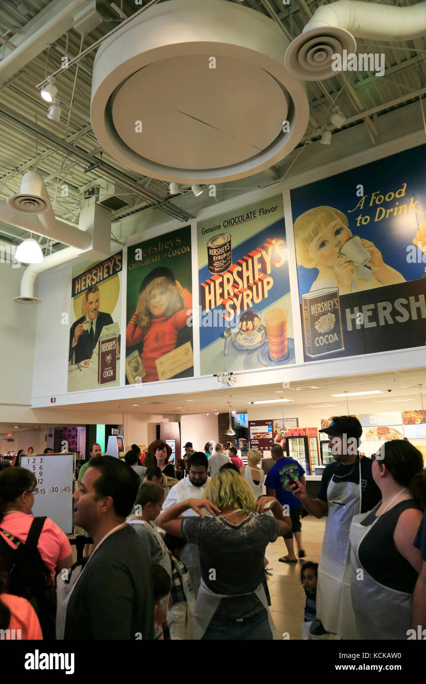 Reproduction of historical Hershey Chocolate posters decorated Create Your Own Candy Bar area in Hershey's Chocolate - Stock Image