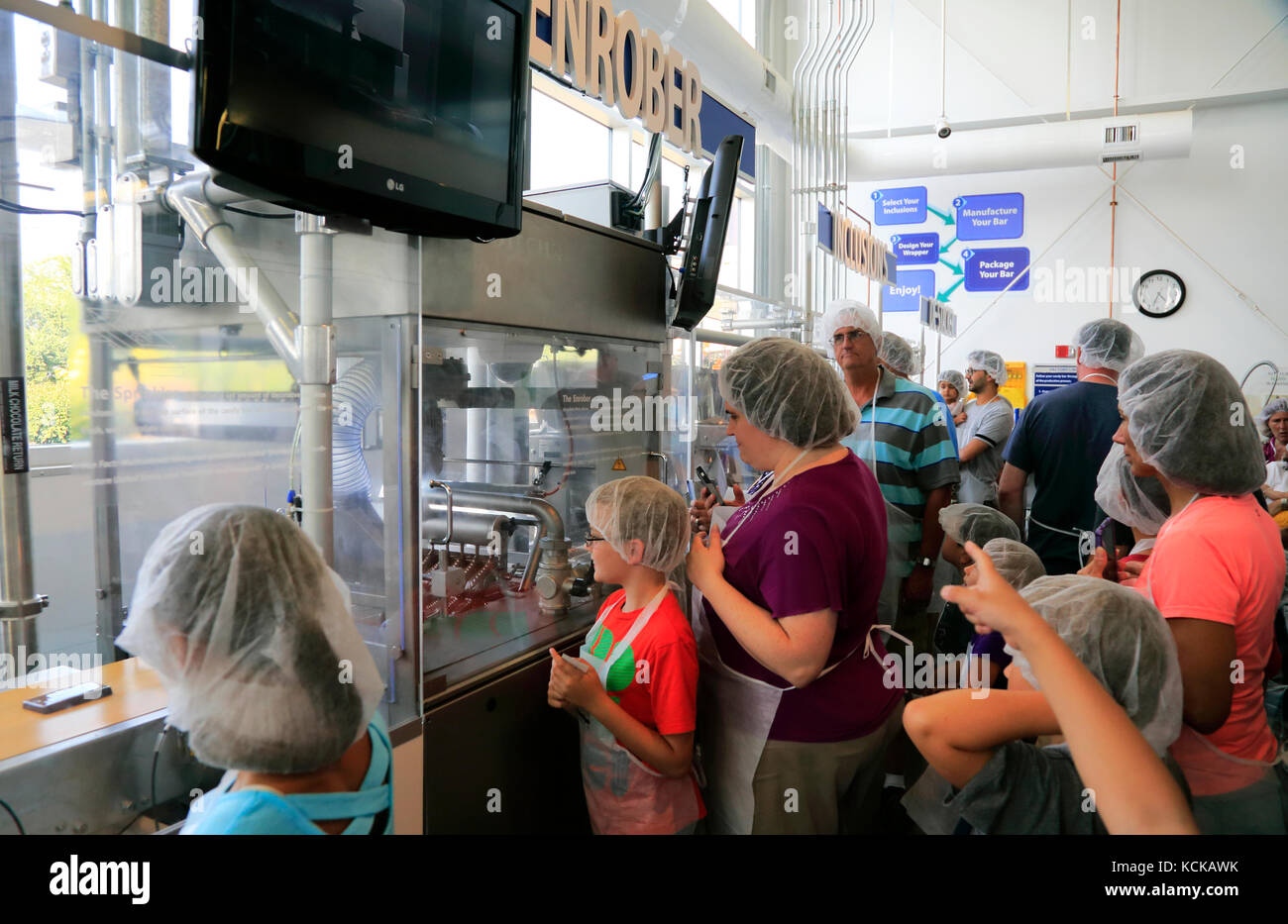 Visitors in Creat-your-own candy bar in Hershey's Chocolate World.Hershey.Derry Township.Pennsylvania.USA - Stock Image