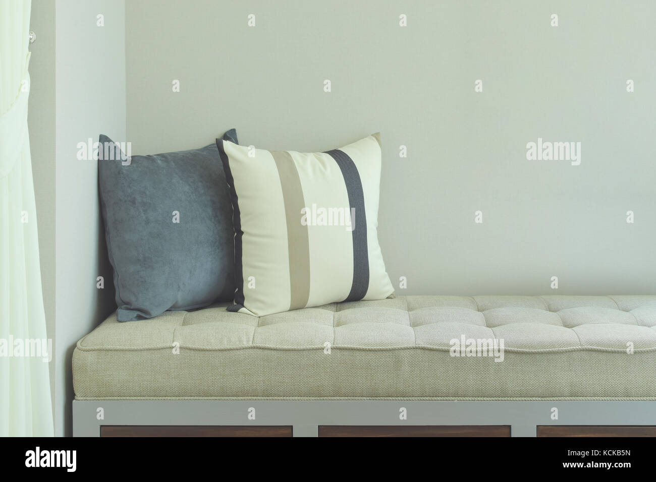 Pillows on comfy seat in living room - Stock Image