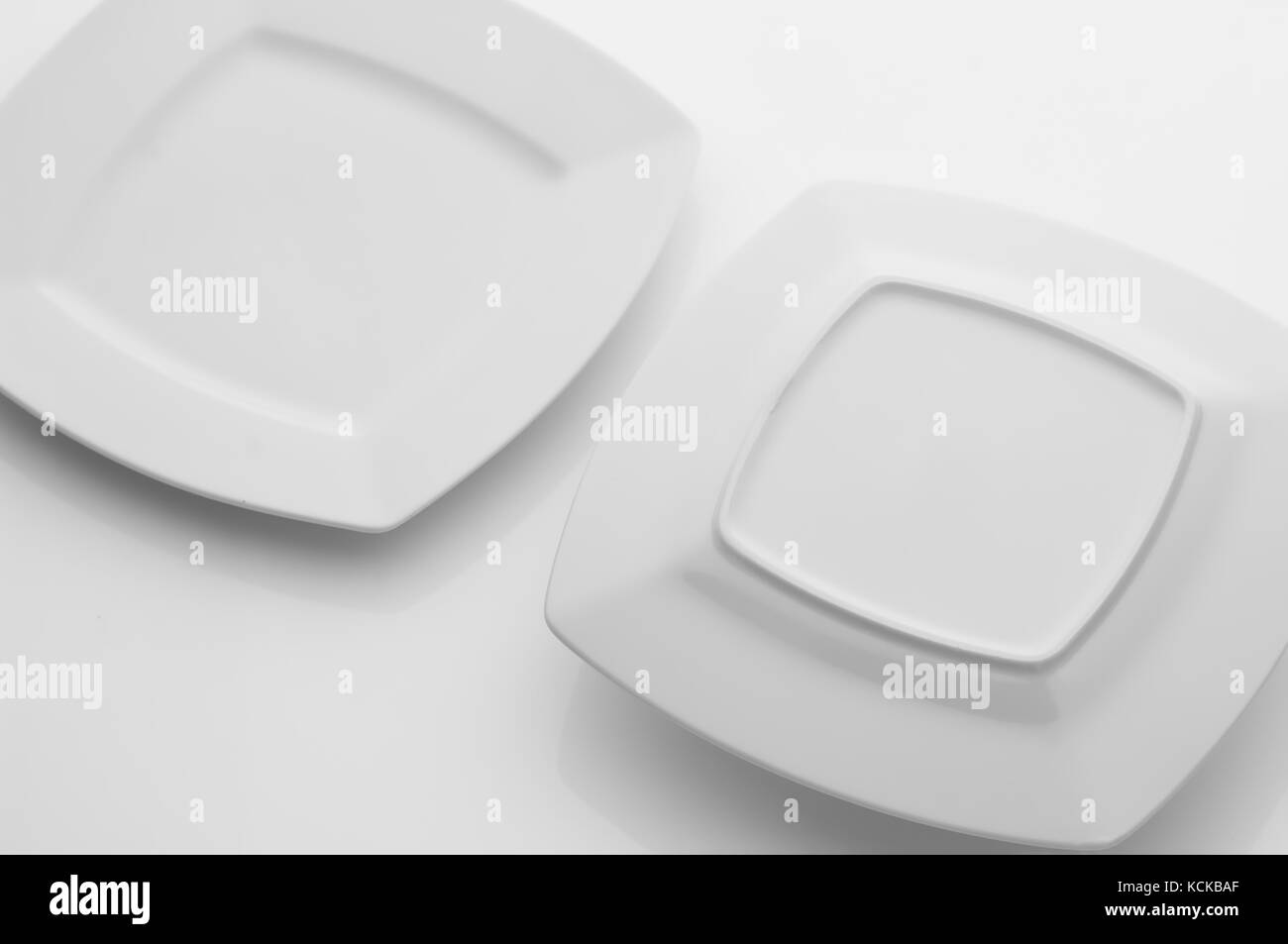 kitchen and restaurant utensils, plates, on a light background - Stock Image