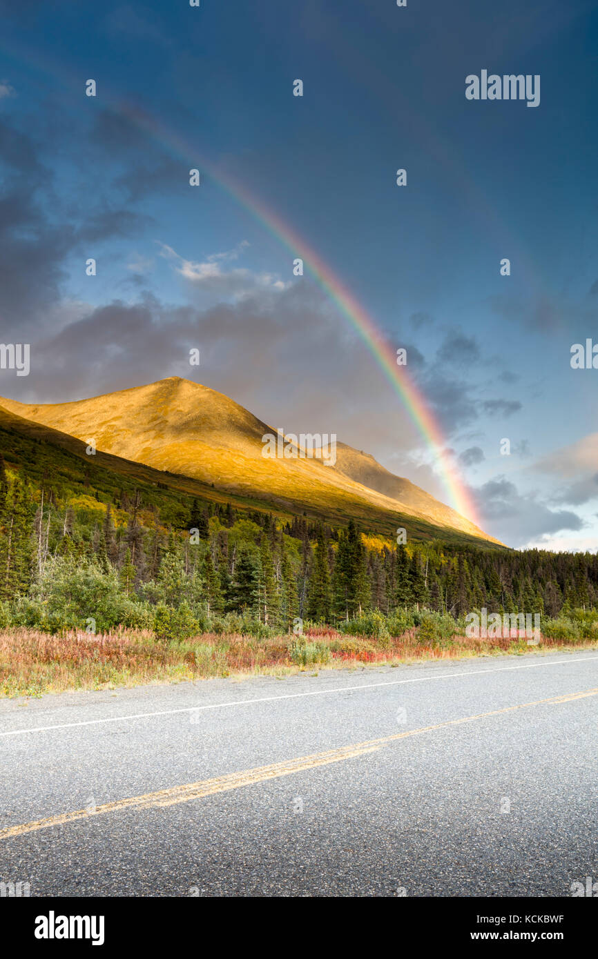 Autumn and rainbows along the Haines Highway in the Yukon of Canada - Stock Image