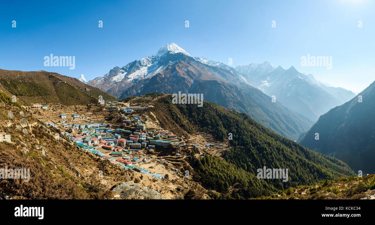 Panoramic view of Namche Bazaar and Thamserku mountain in Solukhumbu district, Nepal - Stock Image