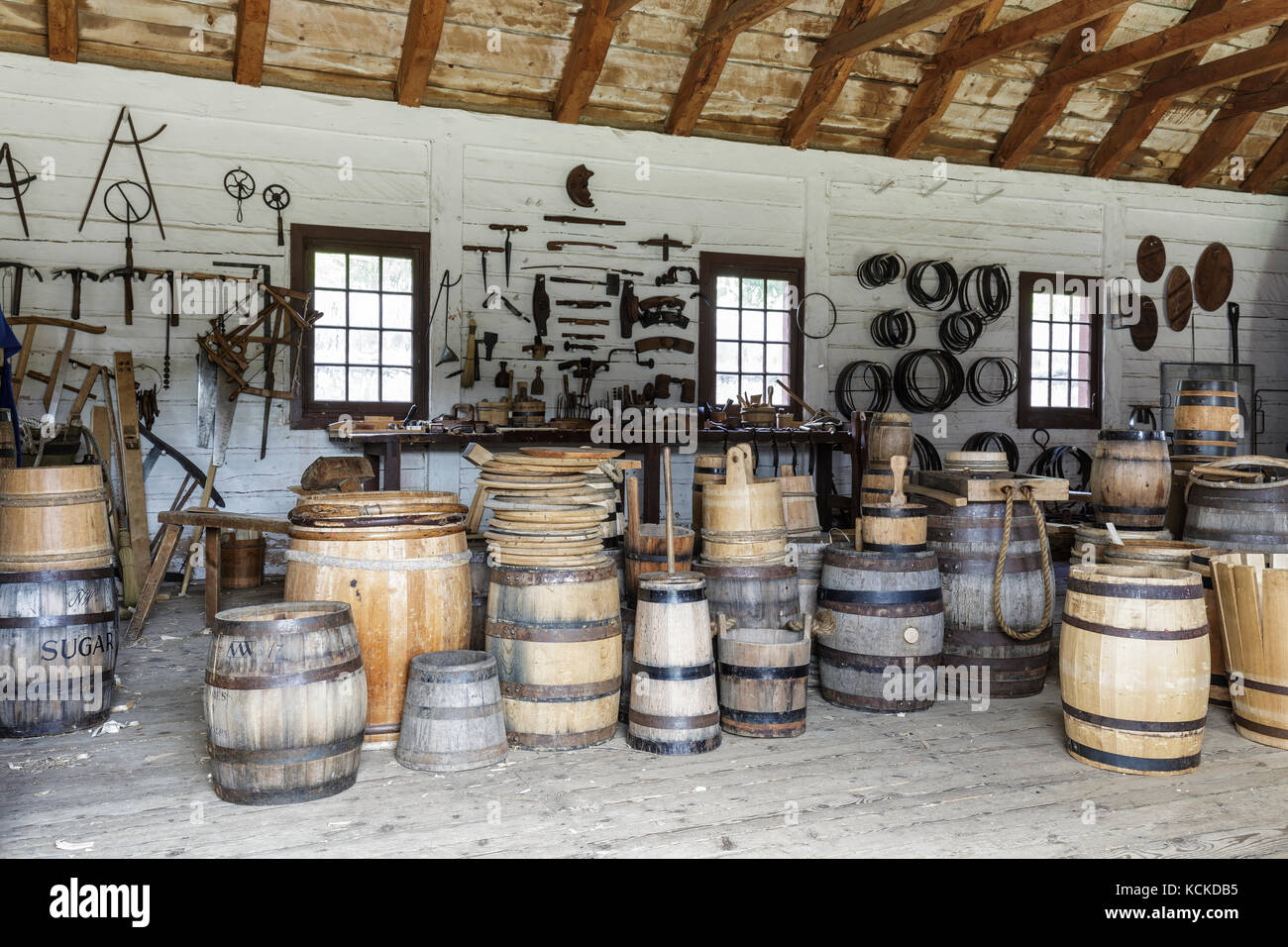 Wooden barrels in the Cooper's Shop at Fort William Historical Park, Thunder Bay, Ontario, Canada - Stock Image