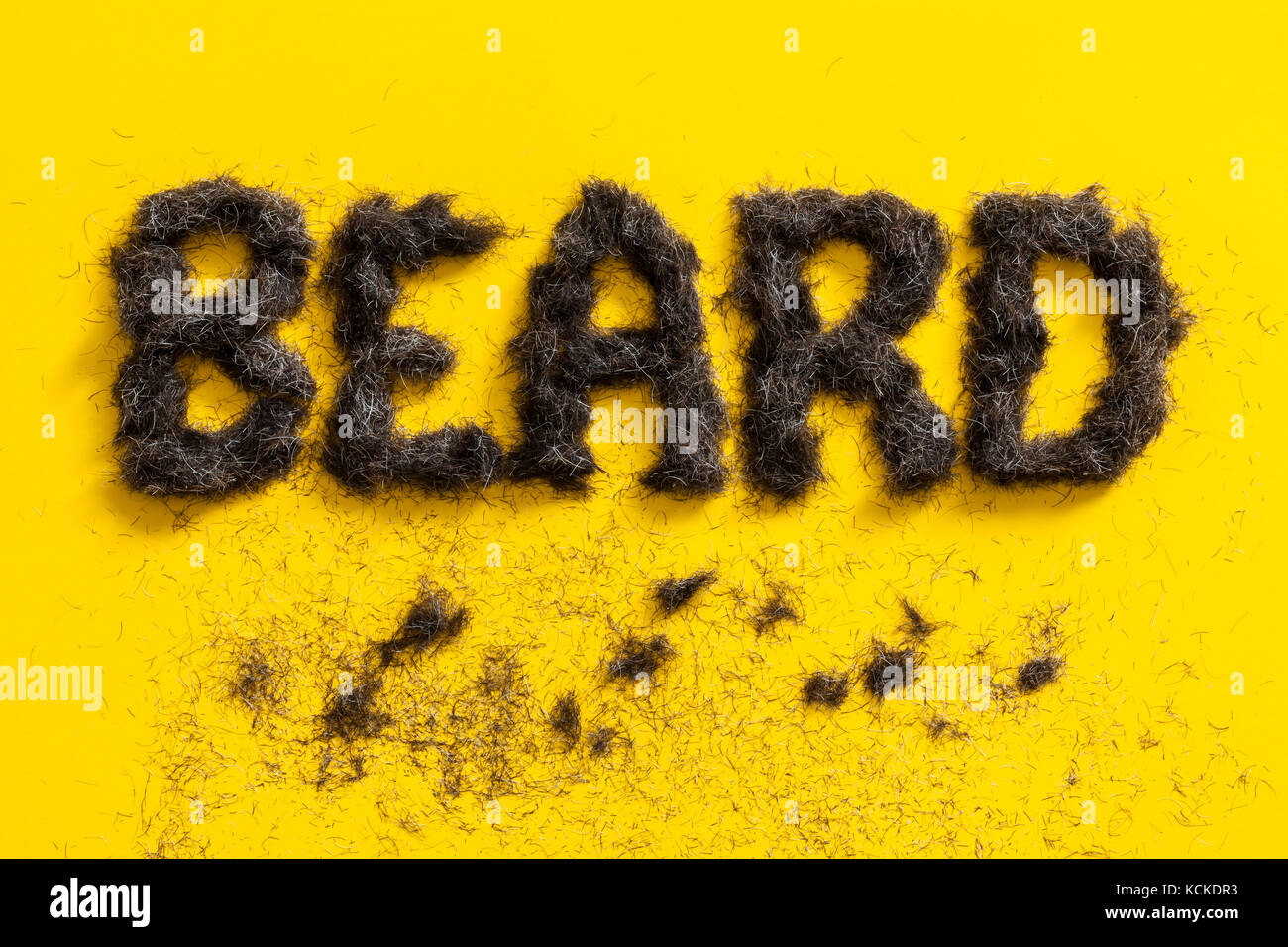 Beard sign made in beard trimming angled on a bright yellow background - Stock Image