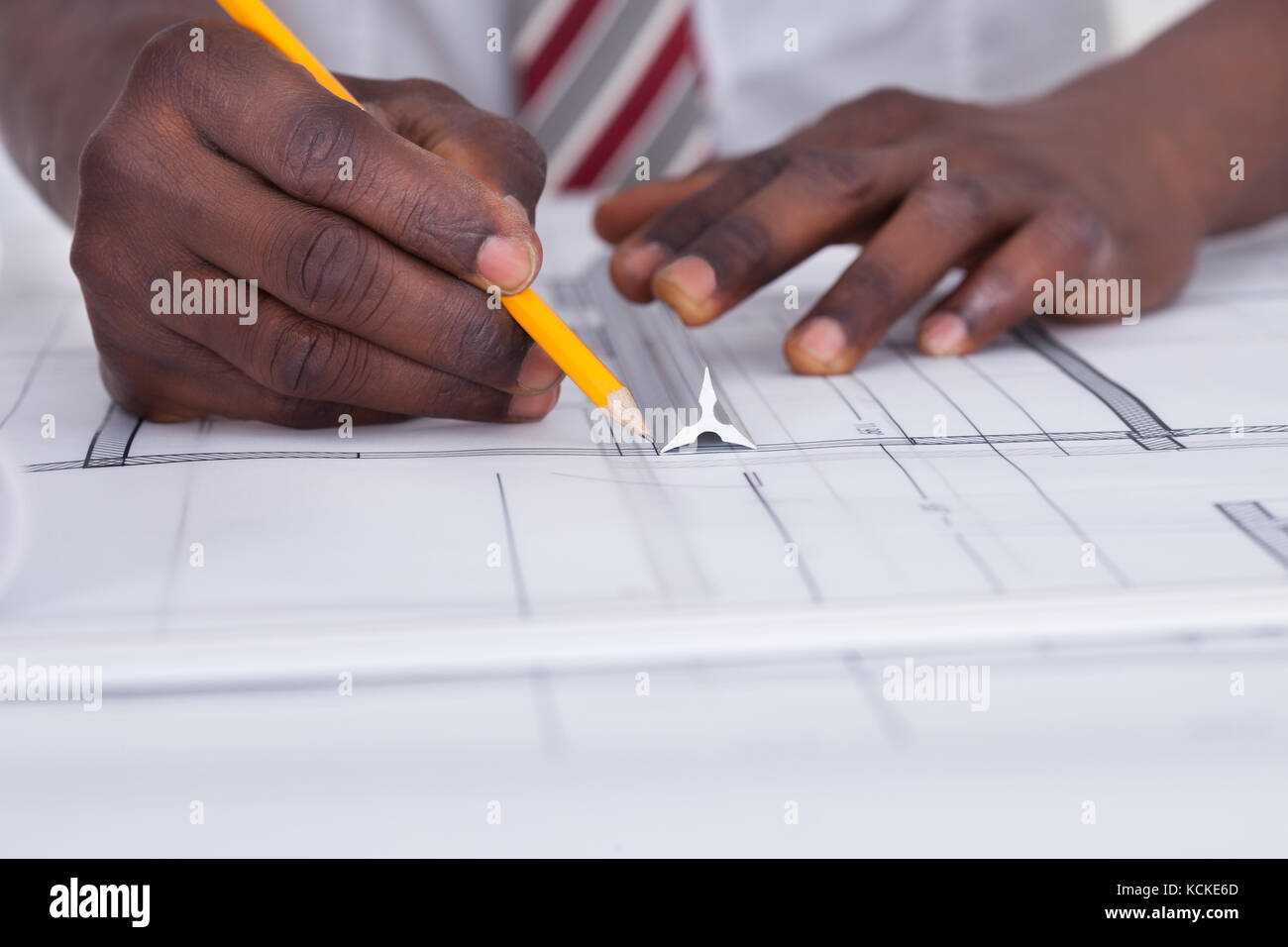 Black construction paper stock photos black construction paper close up of an african architect drawing blueprint stock image malvernweather Images