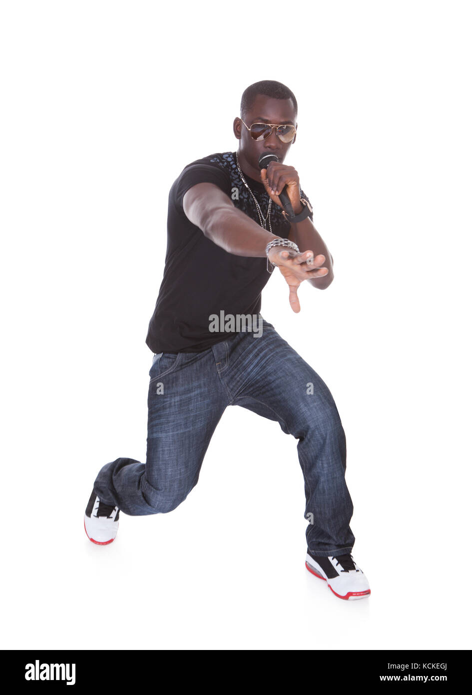 Portrait Of Young African Man Singing On White Background - Stock Image