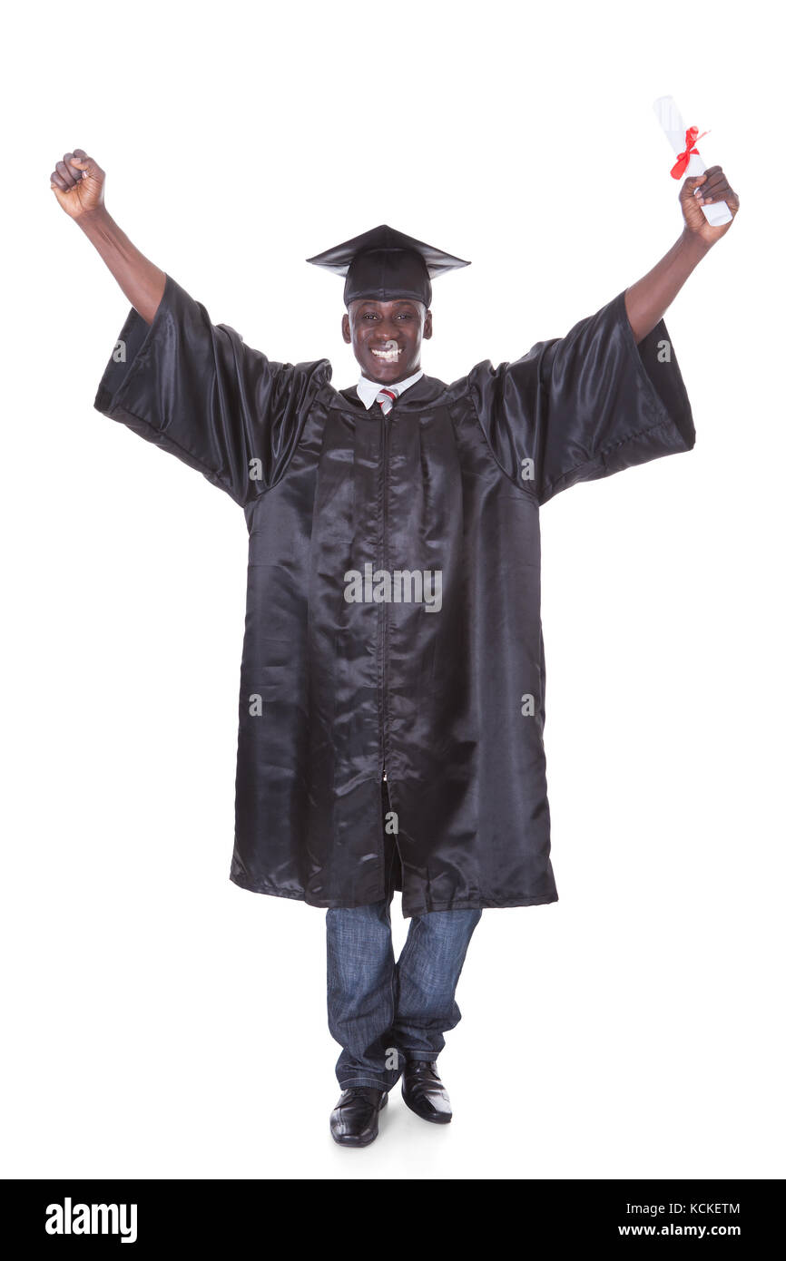 Graduation Man With Diploma Raising Hand Over White Background - Stock Image