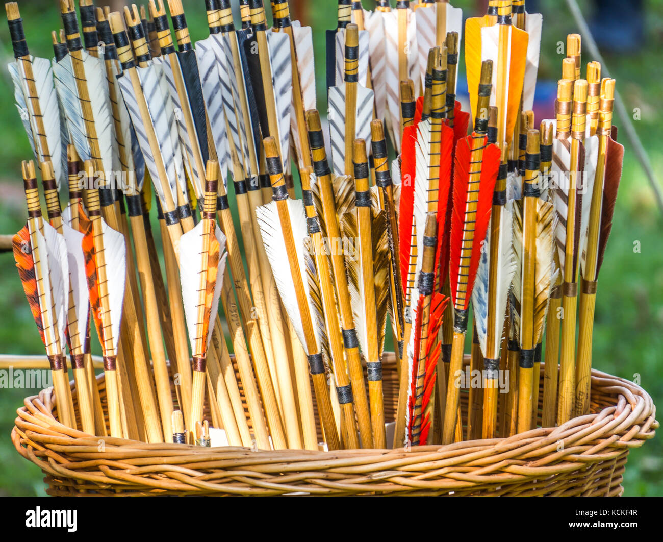 Ships of arrows for a bow in a plaited weasel basket, abstract shot - Stock Image