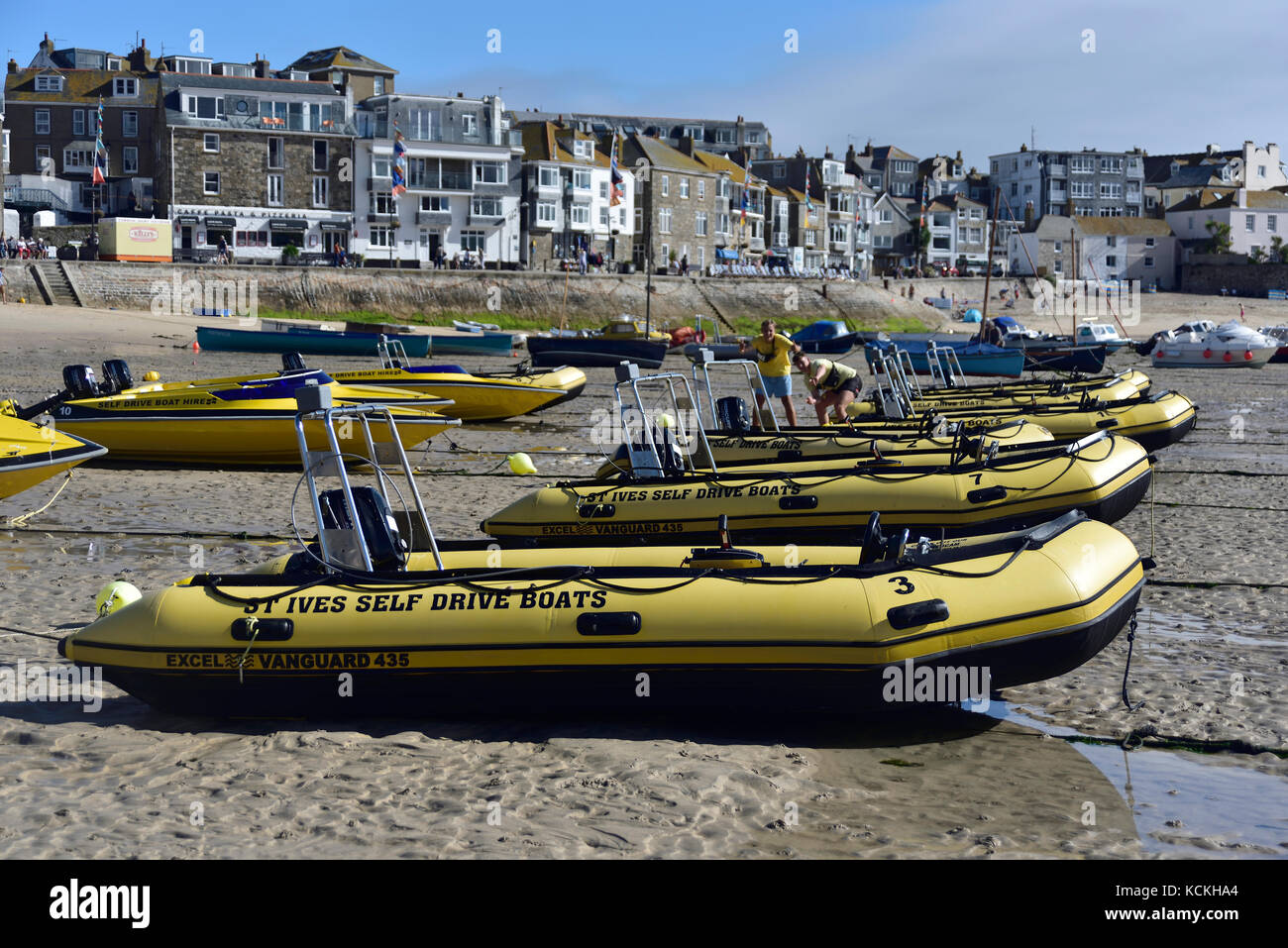 A line of self-drive boats, St Ives, Cornwall - Stock Image