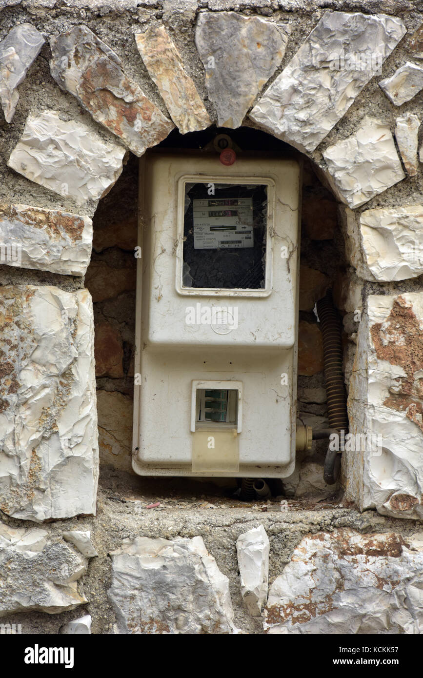 a greek electricity meter in a very ornate and over the top enclosure. A decorative and special gas or utility meter - Stock Image