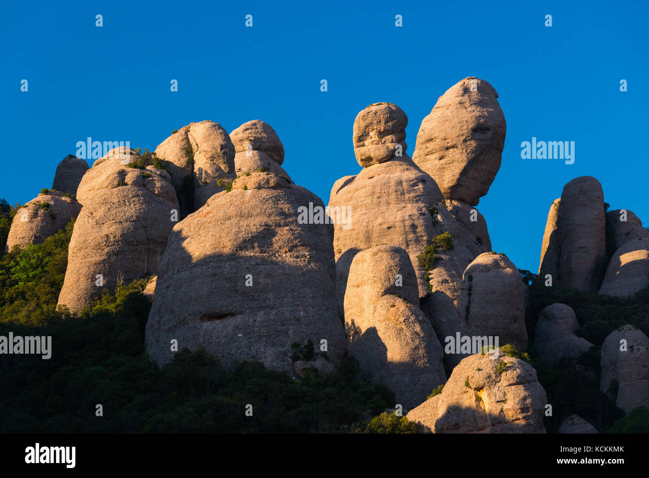 View of the rock formations of El Dit, La Patata and El Lloro in the Montserrat mountains - Stock Image