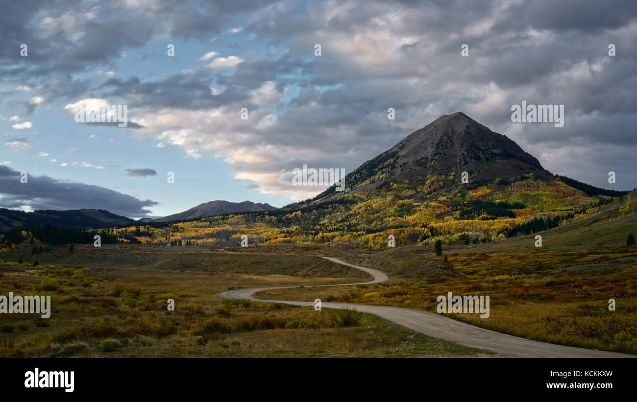 This is the picture of Crested Butte Mountain in Colorado in Autumn with Aspen Yellow leafs. - Stock Image
