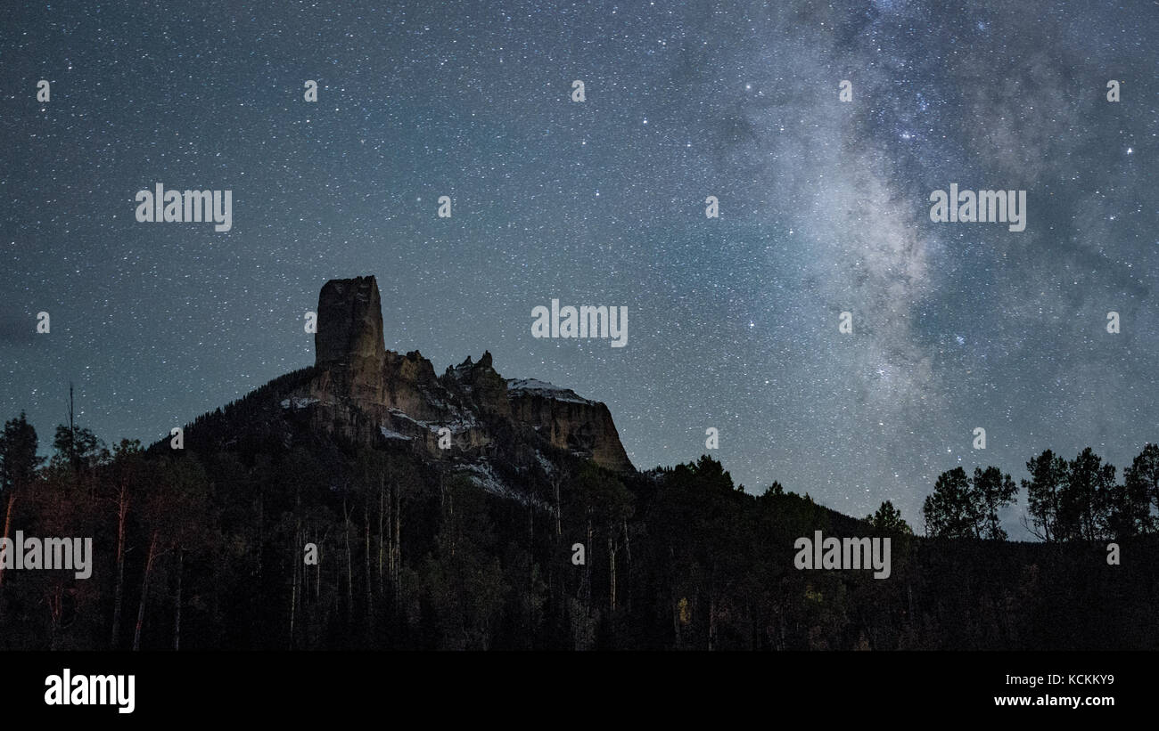 This is the picture of Chimney Rock wth milk way in Colorado during Autumn. - Stock Image