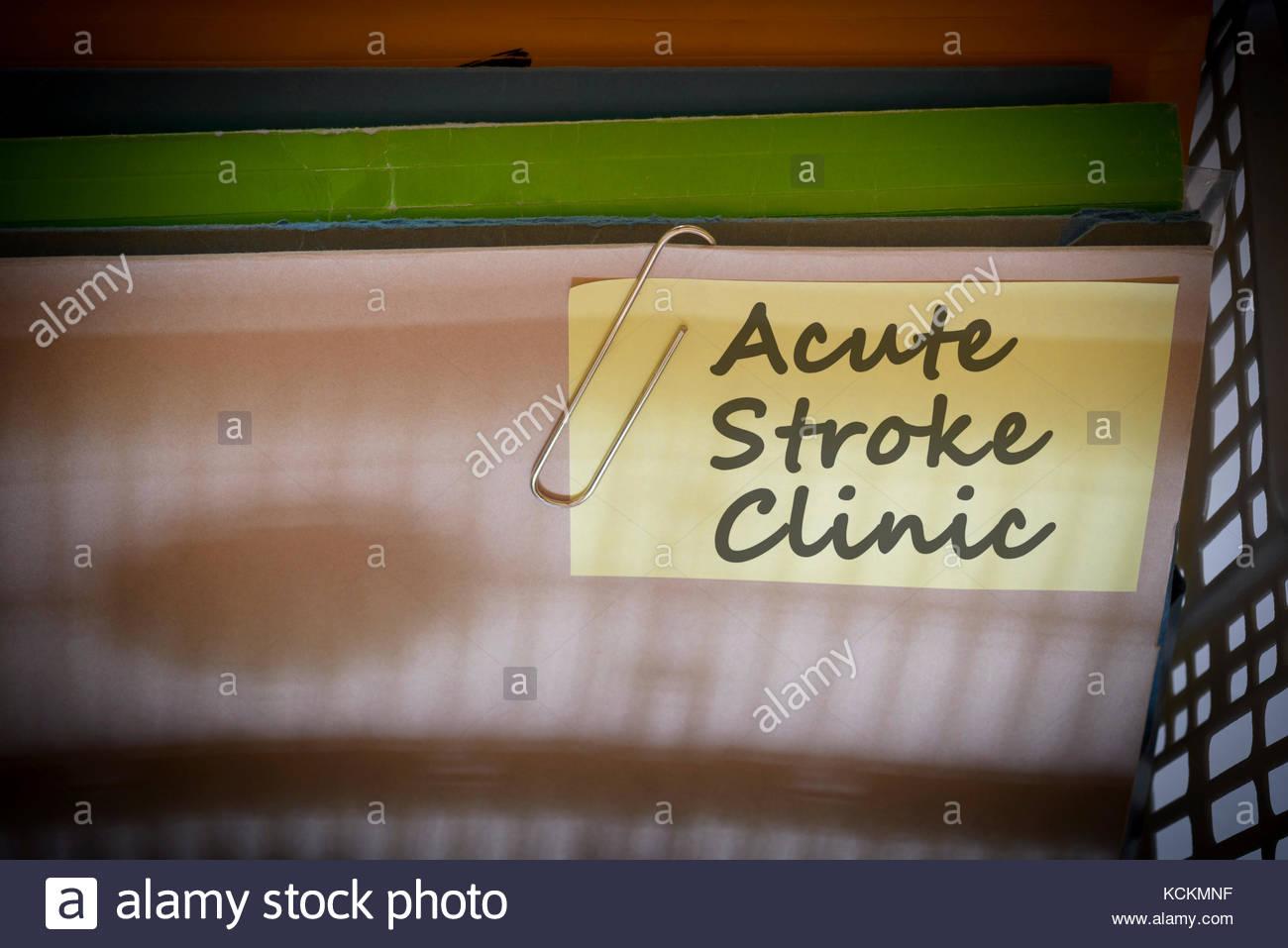 Acute Stroke Clinic written on document folder, Dorset, England. - Stock Image