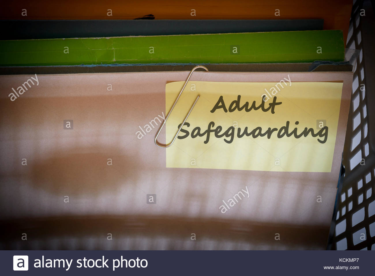 Adult Safeguarding written on document folder, Dorset, England. - Stock Image
