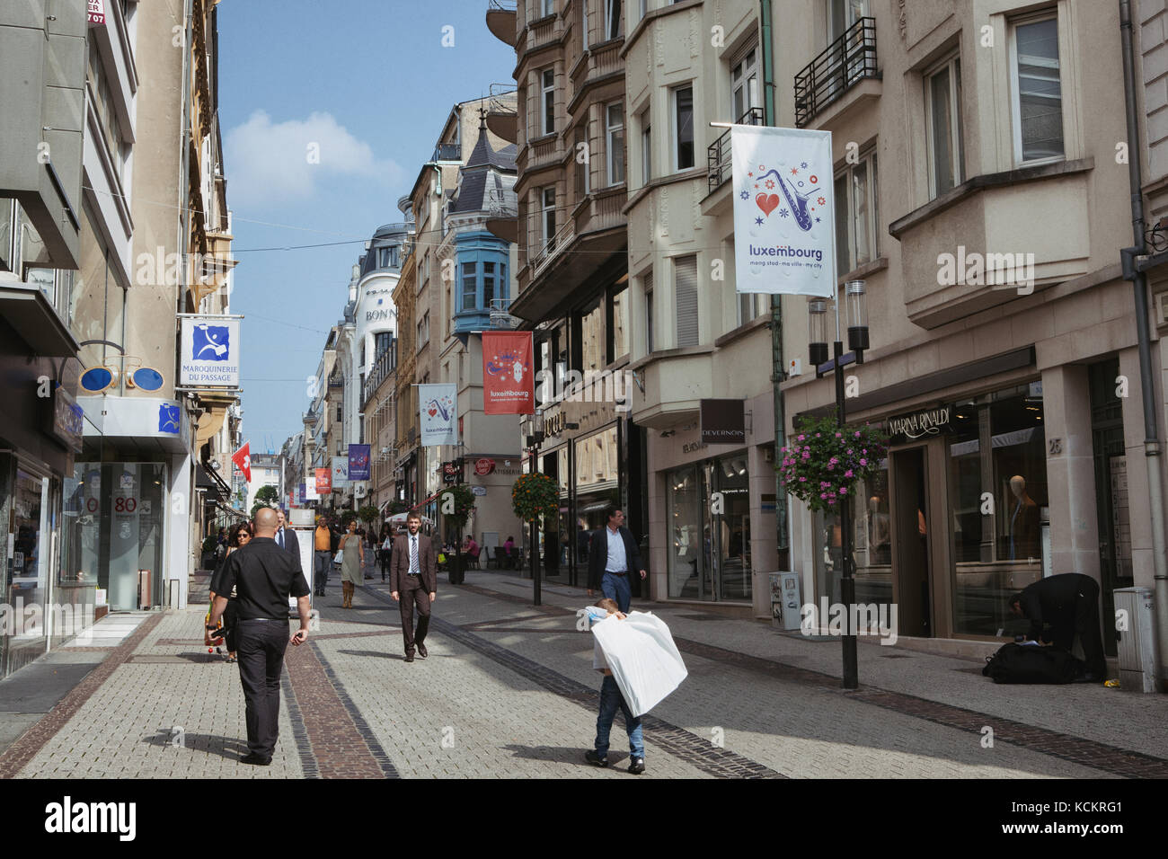 Just another day in Luxembourg, fast paced with a wide array of shops and sights delight any tourist. - Stock Image