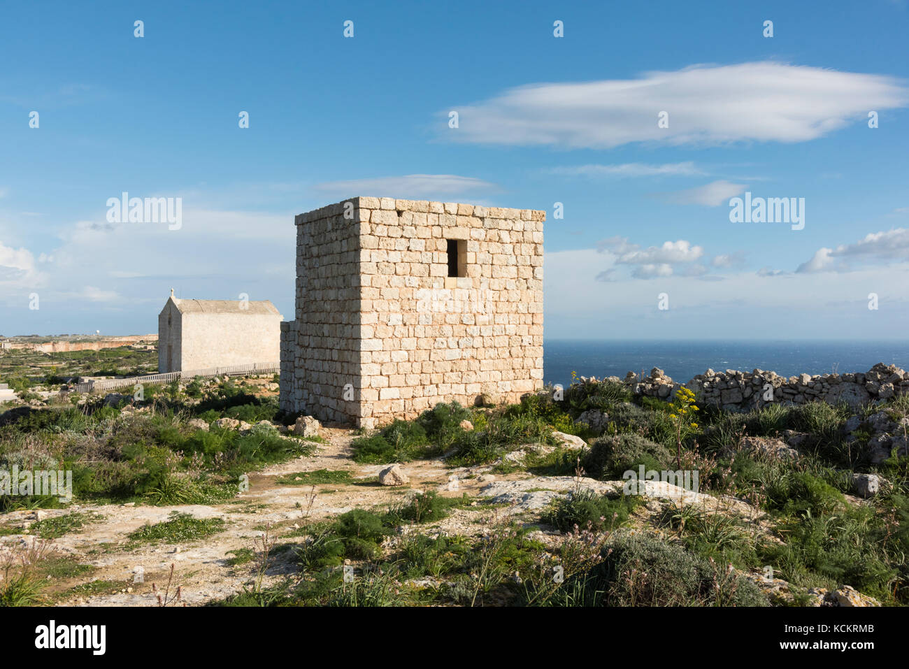 A stone watchtower and the Magdelene Chapel on the Dingli Cliffs Malta - Stock Image