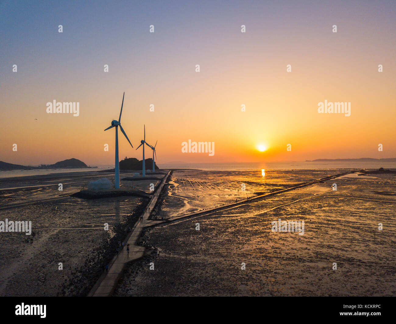 Aerial view Sunset of wind turbine in Daebudo Island,South Korea. - Stock Image