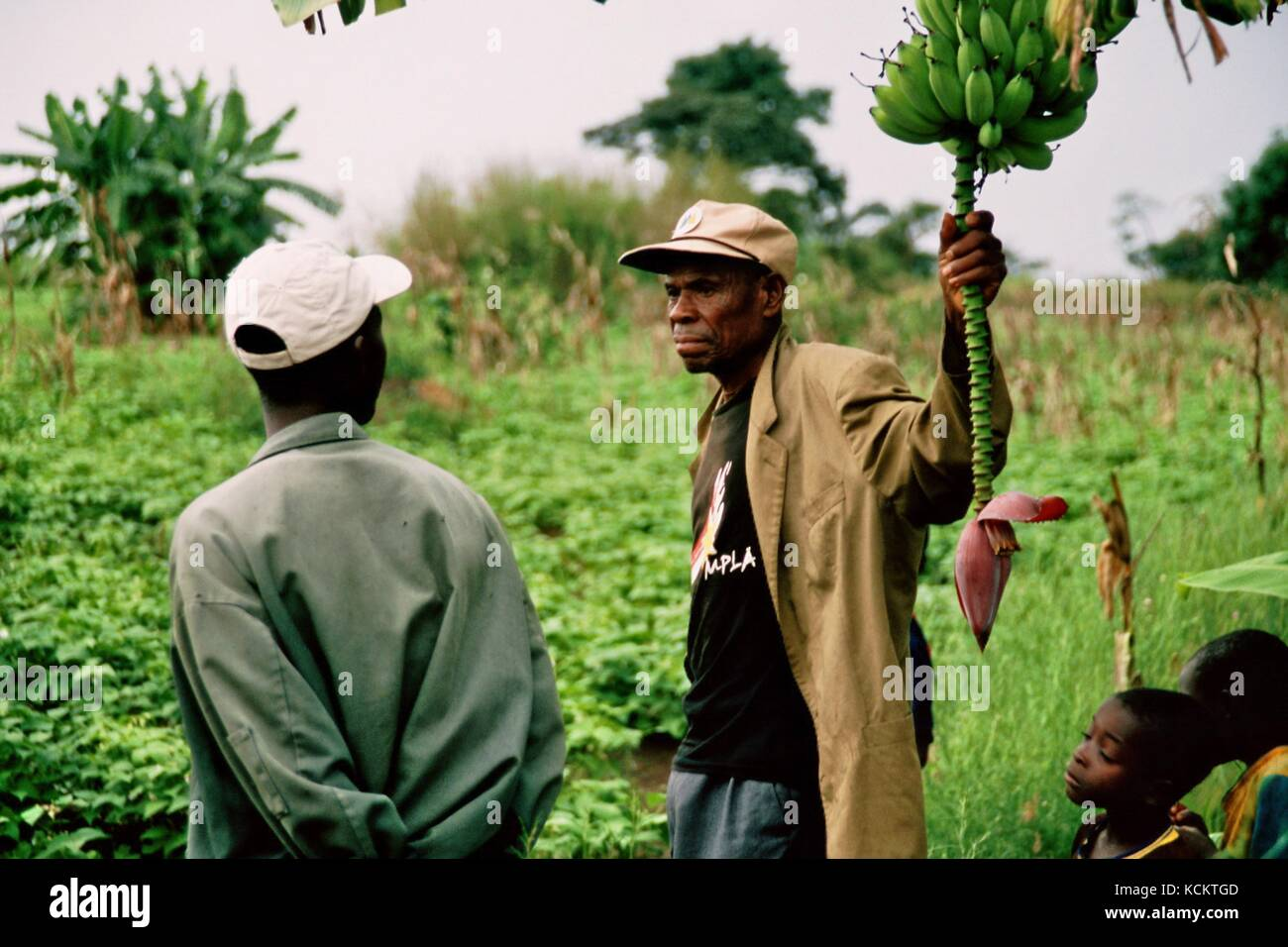 MANGUE, ANGOLA - May 15, 2007: A farmer on his field. The German Welthungerhilfe helps cultivate crops. Stock Photo