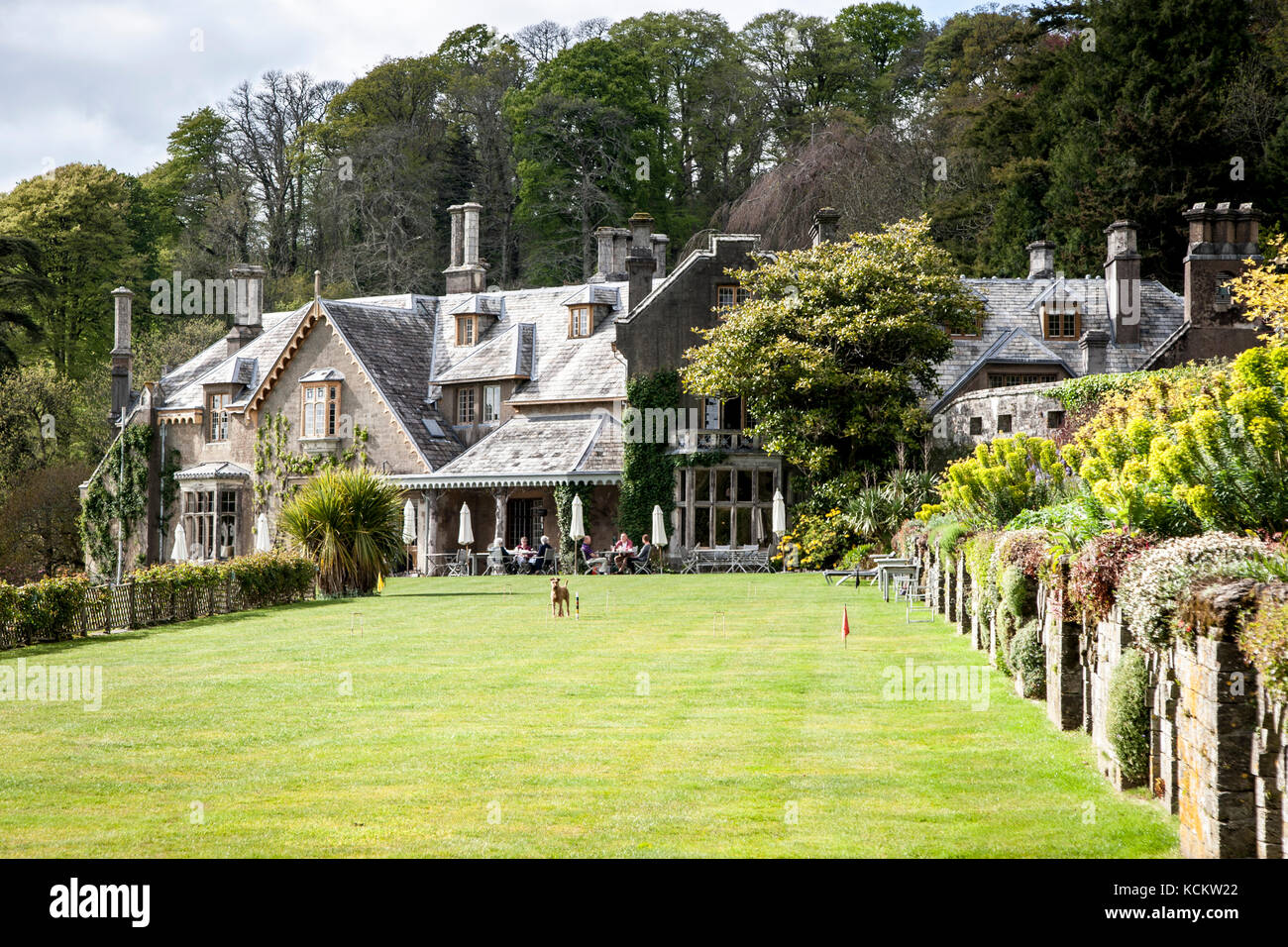 A variety of garden games can be played on the green along the longest decorative patch in England. Hotel Endsleigh in the Lawn Stock Photo