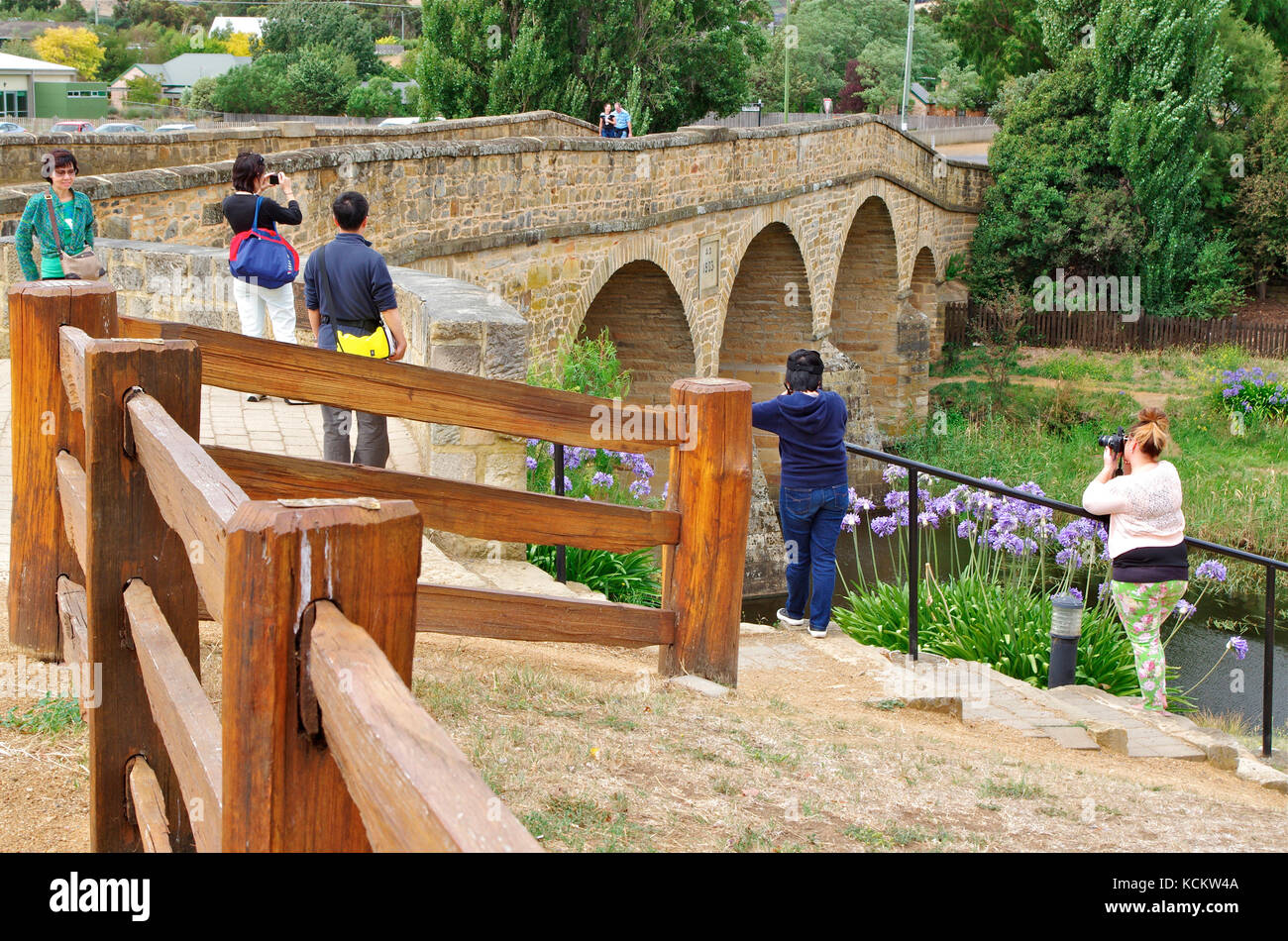 Tourists photographing Richmond Bridge, oldest bridge in Australia, built by convicts in 1823-25. Richmond, Tasmania, - Stock Image