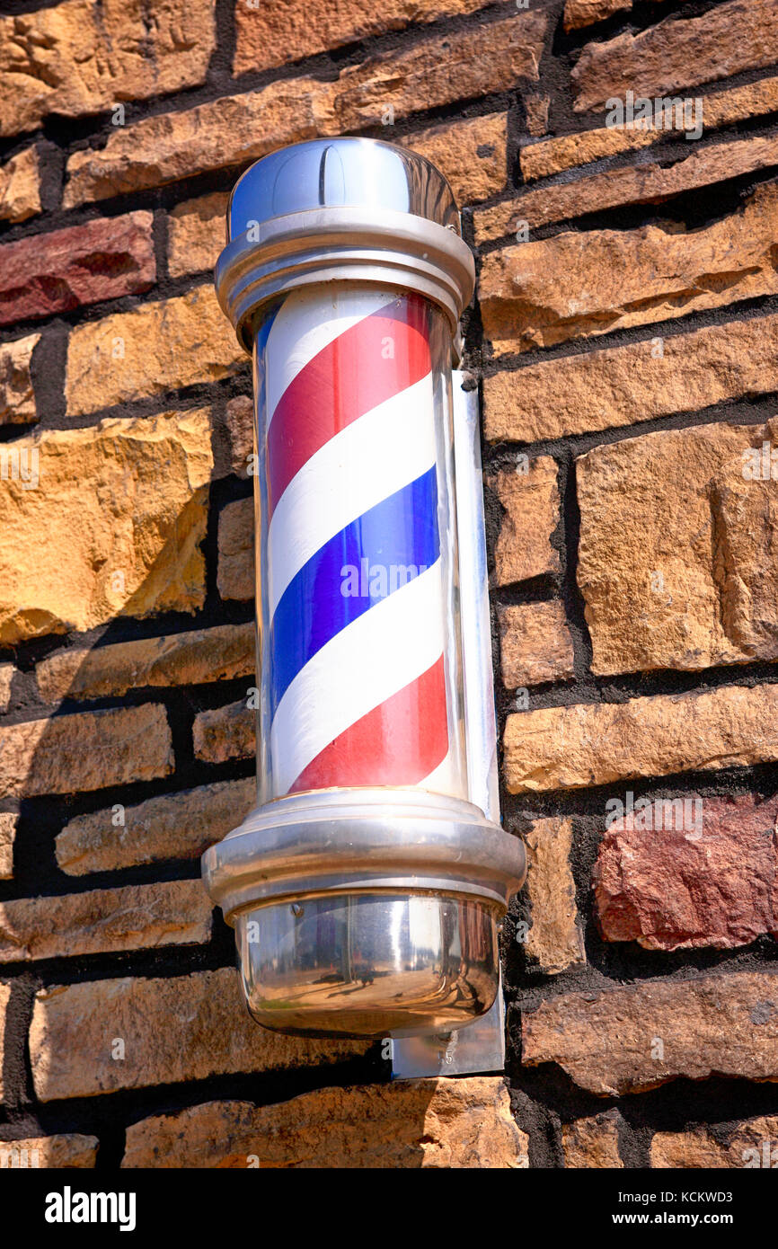 Barbers shop pole on a wall in downtown Lebanon Tennessee USA - Stock Image