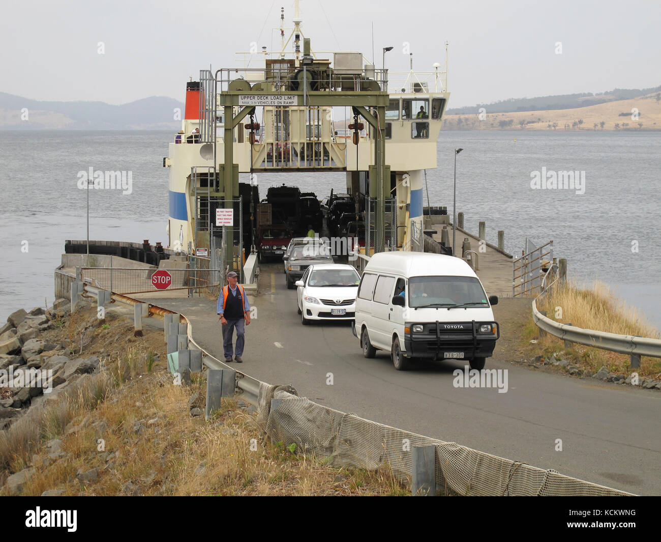 The Bruny Island ferry 'Mirrambeena' unloading passengers and vehicles from Kettering at the terminal on Bruny Island. - Stock Image