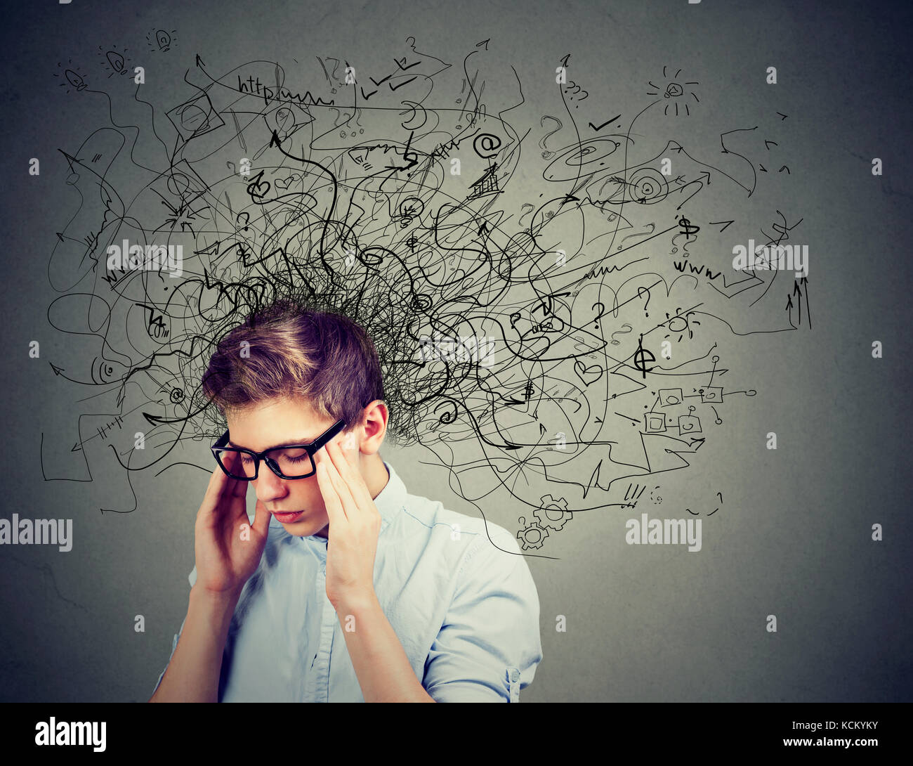 Thoughtful stressed man with a mess in his head - Stock Image