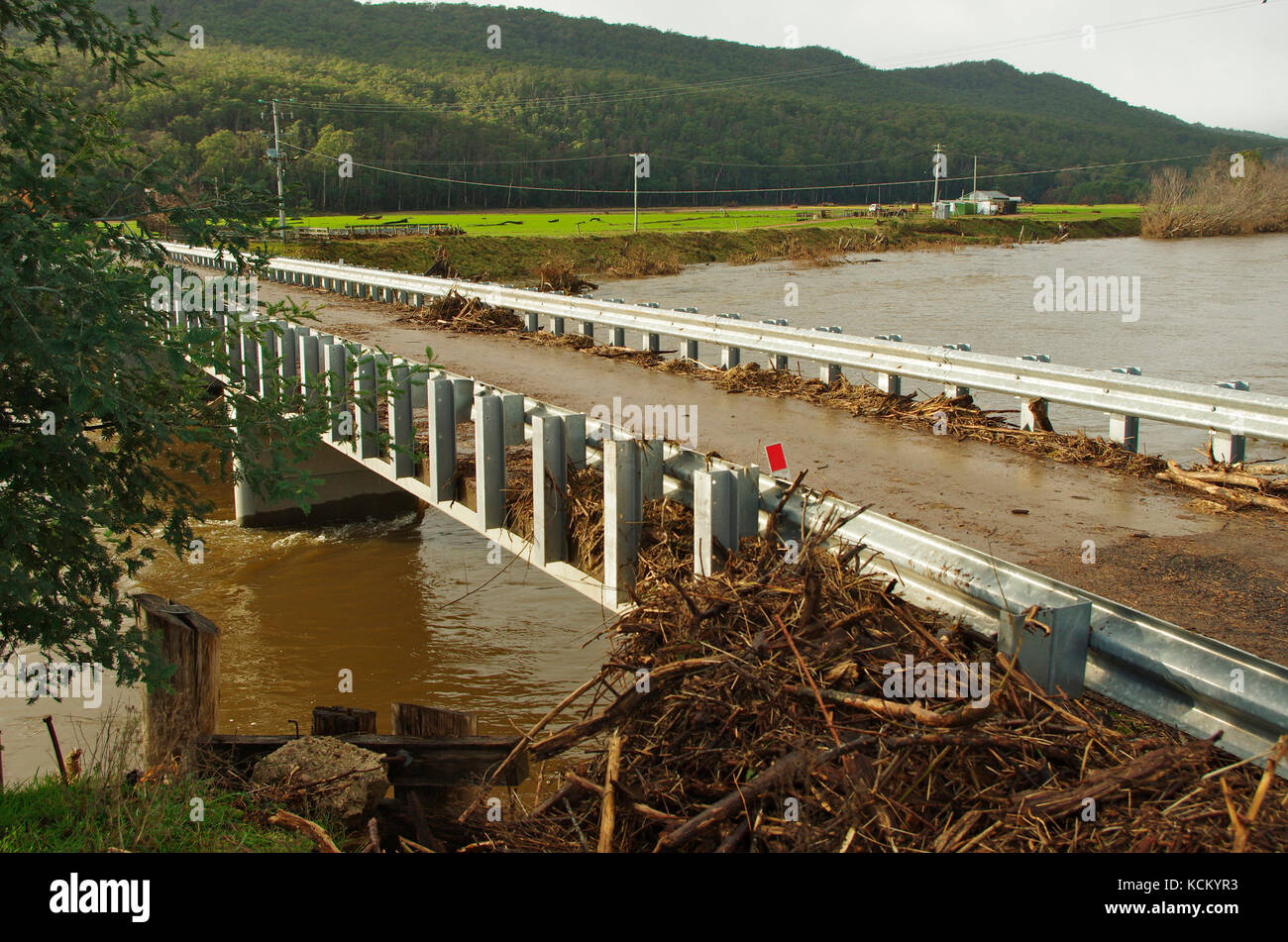Flood debris washed up against Lamberts Bridge as flood waters recede. Mersey River Valley, northwestern Tasmania, - Stock Image