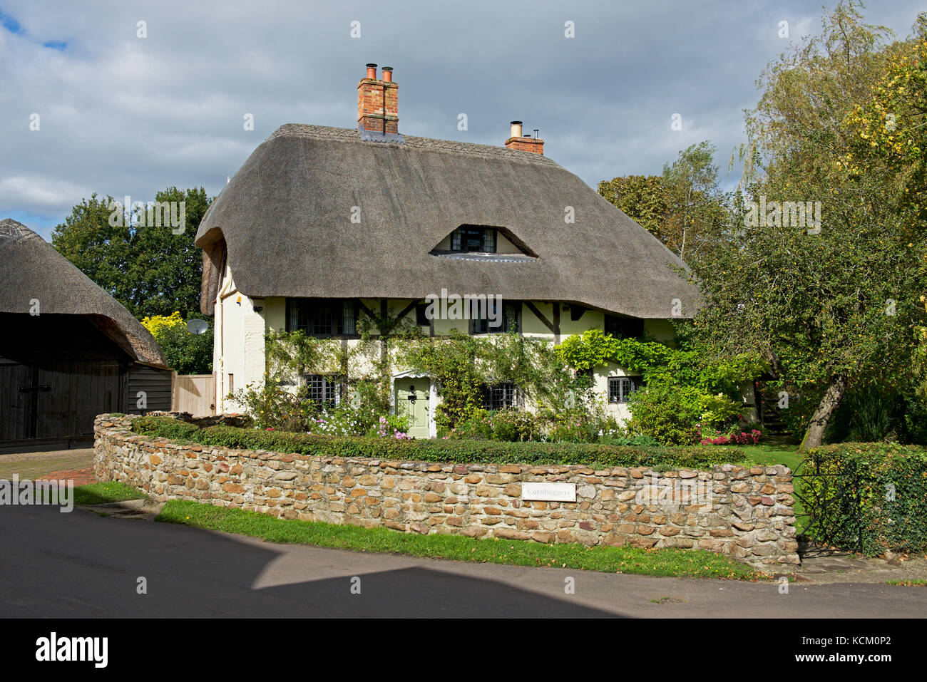 Thatched cottage in the village of East Garston, Berkshire, England UK - Stock Image