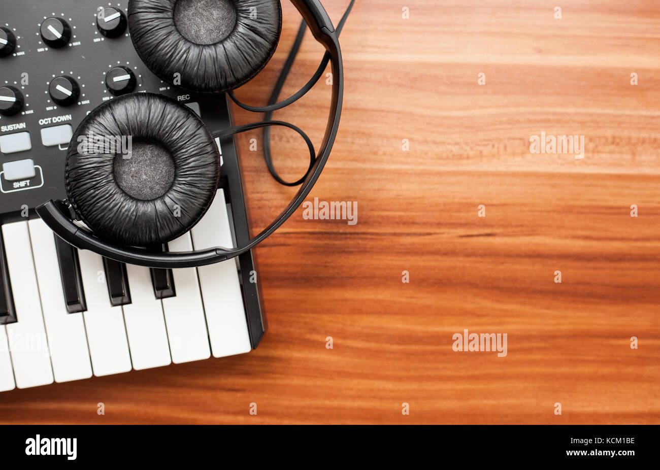 closeup photo of a mini keyboard with a pair of headphones - Stock Image