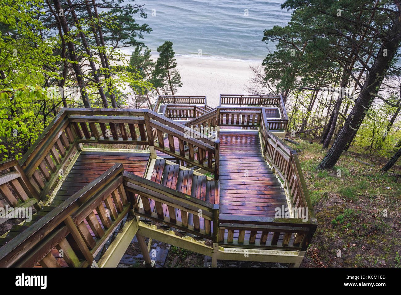 View from the top of wooden stairs on Baltic Sea beach in Miedzyzdroje seaside resort on Wolin Island in West Pomeranian - Stock Image